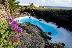Jameos del Agua, Canary Islands.  the eruption of La Corona Vulcano.It owes its name to the existence of an internal lake which constitutes a unique geological formation. It originates by filtration through the rock which lies below sea-level.