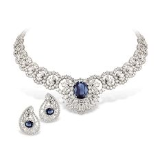 A breathtaking necklace of round, pear-shaped, and marquise cut diamonds, with a central diamond and blue sapphire on white gold, with matching earrings.