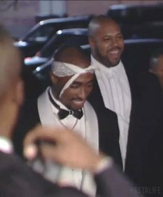 Viva La Tupac.  Only he could do rabbit ears with a tux and carry it off in style.