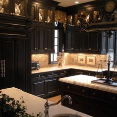 I love the lighting in the top cabinets!