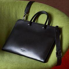 While I wait.  Clean lines and brushed leather. The Prada briefcase.  #PradaMiseEnScène  #PradaFW17 #Prada365  Link in bio.  via ✨ @padgram ✨(http://dl.padgram.com)