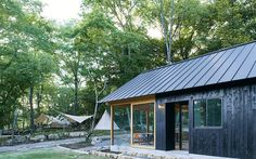 japanese design studio mori no terrace has created a camping café called 'terrace of the forest' using locally sourced material in osaka, japan. Black Shed, Black House, Norway House, Gable House, Rural House, Getaway Cabins, Terrace Design, Wood Siding, Japanese Design