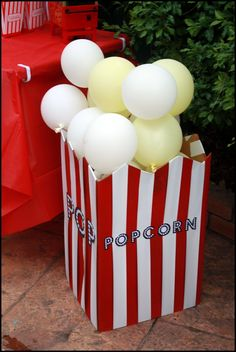 Huge popcorn box topped w/balloons for popcorn! Circus - Carnival Party!