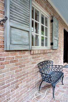 love the shutters, iron bench, and brickwork floor...