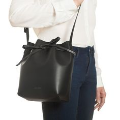 """Mini Bucket Bag Black 9.5"""" H X 8"""" W X 4.5"""" D Italian vegetable tanned black leather mini bucket bag with red interior matte patent. Adjustable strap. Made in Italy.  $460.00"""
