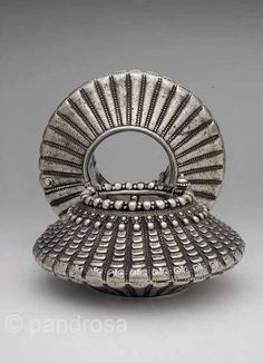 India   Pair of old silver anklets from Madya Pradesh   Hollow but heavy; in the rural community, these anklets would have been an important dowry asset    ca. first half of the 20th century   Screw hinge opening   4'850$