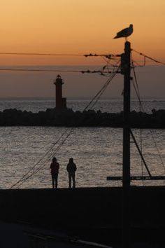 Red glow of Oshidomari Ko lighthouse Rishiri, Japan http://www.unc.edu/