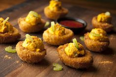 Buffalo Fried Deviled Eggs - - Yep, that's right—we fried them. Surprisingly easy to make, these are definitely a conversation starter. Of course you could serve them the traditional way, but we think everything is better fried. Fried Deviled Eggs, Deviled Eggs Recipe, Egg Recipes, Other Recipes, Cooking Recipes, Healthy Recipes, Appetizer Dips, Appetizer Recipes, French Tips