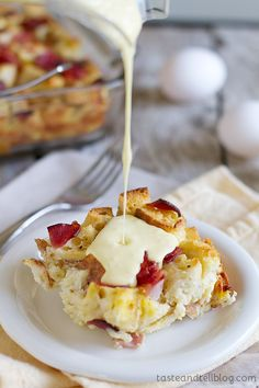 Eggs Benedict Strata - An overnight casserole with the flavors of eggs benedict is served with an easy blender hollandaise sauce poured over the top.