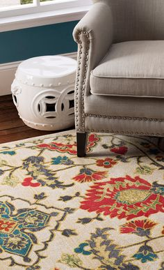 Accent a boho-chic space or anchor a neutral seating group with this eye-catching rug, featuring an artful botanical motif. Make it yours at jossandmain.com