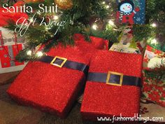 "Santa Suit Gift Wrap - Red wrapping paper,1-1/2- 2"" black ribbon,  Poster board or gift box (for buckle),  Gold or silver paint:  Wrap gifts in red paper. Wrap black ribbon around the center, taping it in the back. Cut out the buckle. Paint the buckle. When buckle is dry, secure buckle to ribbon w/adhesive."