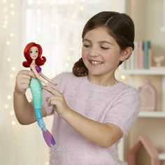 Explore the latest Toys at the worlds greatest Toy Store including LEGO, Toy Story Disney, Star Wars and much more at Toys R Us Disney Princess Characters, Ariel Doll, Girl Hair Colors, Ballerina Birthday Parties, Red Dolls, Mermaid Swimming, Doll Eyes, Tiana, Toy Store