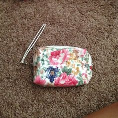 Norstroms make up/ wristlet Sparkly flower printed bag. Can be used as a wristlet. Strap can be unhooked from the bag. It can be used for anything you would like. Has three compartments. One zip up section. Bought at norstroms never used. Perfect condition Nordstroms  Bags Clutches & Wristlets
