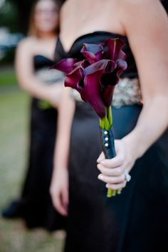 Perfect for a bridesmaid. The saris are purple so maybe use red lilies? Also, what should we do for Lora? A bouquet might be too many things to hold if she has notes. A wrist corsage?