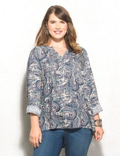 Rev-up your fall style with this super chic paisley top. The soft blue hues will bring out the blue of your jeans, and when you add a bangle or two with your favorite wedges, you'll have an  effortlessly stunning look. Imported.
