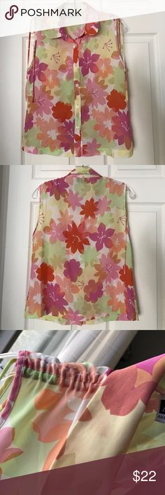 Floral Anne Klein top Perfect for spring! 🌸 bright, vibrant floral printed tank. Large armholes, scrunched shoulder tops, strings hang down shoulders when not tied. Collared top, buttons down front middle, back is all pattern. Anne Klein Tops