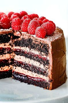 Chocolate Raspberry Cake with sliced removed showing layers of dark chocolate cake, raspberry jam filling, chocolate ganache and chocolate mousse Chocolate Raspberry Cake, Dark Chocolate Cakes, Chocolate Desserts, Chocolate Ganache, Raspberry Cake Filling, Chocolate Cake Fillings, Raspberry Lemonade Cake, Chocolate Mousse Cake Filling, Strawberry Cakes