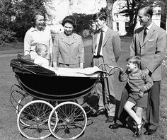 This photograph has been used by Queen Elizabeth II of England for her Christmas cards this year. Picture is of the royal family on grounds of Windsor Castle, Dec. 19, 1965 in Windsor. The Queen and Prince Philip stand with their children, who are, from left, Prince Charles, 17; Princess Anne, 15 and Prince Andrew, 5. In the pram is Prince Edward, age one. (AP Photo)