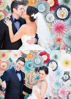 DIY paper flower photo booth backdrop.  Tea Length Wedding Dress.  Gingham Groom.