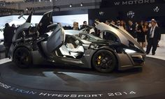 Visitors look at W Motors' Lykan HyperSport car at the Dubai Motor Show