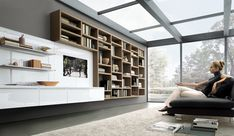 20 Contemporary Living Area Wall Units for Book Storage from Misuraemme : 20 Modern Living Room Wall Units With Brown Wall Glass Roof Window Brown Sofa LED TV Carpet Hardwood Floor Living Room Wall Units, Living Spaces, Living Rooms, Living Area, Interior Design Living Room, Living Room Designs, Design Room, Library Design, Room Interior