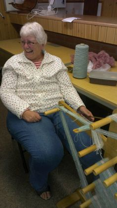 October | 2014 | Worstead Guild of Weavers, Spinners & Dyers. Margaret Gilhom having great fun on an inkle loom