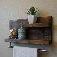 Handmade 2 tier bathroom shelf with satin nickel towel bar. The perfect addition to any home bathroom, apartment, or condo. Made from solid wood. It has been lightly sanded down, then stained and sealed with a beautiful dark walnut finish. This piece does not include the accessory items as