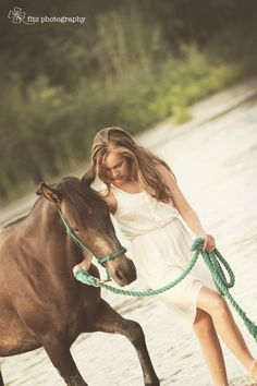 Girl and her horse river