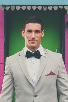 Hansom Groom in tan with navy and pink touches.