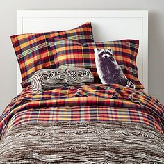 Love the Pendleton-style plaid sheets. Would want a more basic duvet (less themey). Very light walls to keep the room bright.