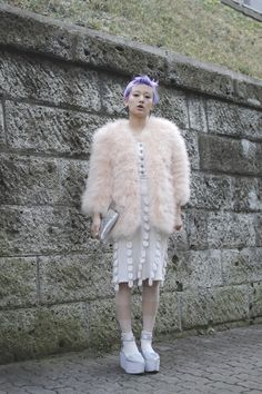 lavender hair, pastel pink fur coat, white sweater dress, platform sandals