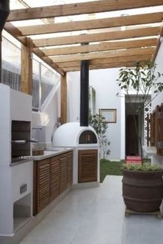 love the plaster outdoor kitchen