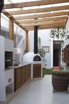 love the plaster outdoor kitchen
