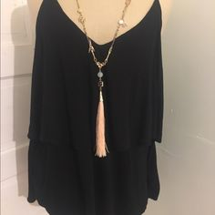 Anthropologie Everleigh Top Black tank top with a tier in the middle. Very loose and very cute. Everleigh from Anthropologie. Anthropologie Tops Tank Tops