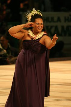 Gorgeous Hula Dancer. The grace and elegance is astounding! I had the wonderful Experience of Watching her Dance!