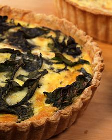 SWISS CHARD QUICHE  6 tablespoons all-purpose flour, plus more for work surface  1/2 recipe Flaky Tart Dough  10 large eggs  2 cups creme fraiche  2 cups whole milk  2 teaspoons salt  1 teaspoon freshly ground black pepper  2 tablespoons finely chopped fresh thyme  2 heaping cups torn Swiss chard leaves  1/2 cup Gruyere cheese