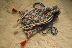 second item for my artfire shop… a small pouch with 14th century German Brick Stitch pattern