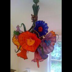 Fantastic blown glass bouquet chandelier  you can find it here: http://www.newtglass.com/flower-bouquet-maine/gallery-131/