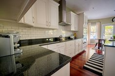 creamy tiles to coordinate with cabinets; gray grout to coordinate with counter top.