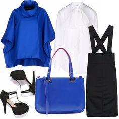 Ecco una proposta di outfit per l'arrivo della mezza stagione: camicia bianca con fiocco, particolarissima gonna salopette e sopra mantellina blu elettrico. Scarpe nere e borsa blu a completare l'outfit.