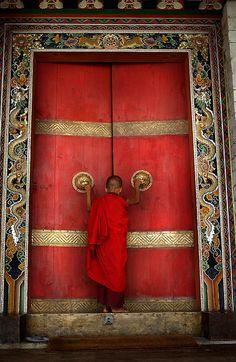 BHUTAN:THE LAST SHANGRI LA 2: A Buddhist monk enters the formidable doors of Trongsa Dzong, the Ancestral home of BhutanÕs monarchy. The Him...