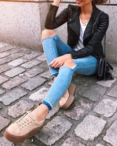 moto jacket + ripped jeans + puma creeper sneakers