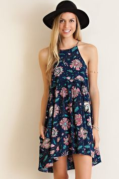 "It is so funny because we are not normally ""floral"" girls... but this sweet sundress has us swooning. We love the semi high-low style. This lightweight fabric is non-sheer and has the cutest coloring!"