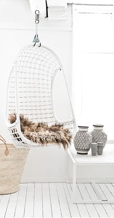 hanging chair and faux fur | Paulina Arcklin