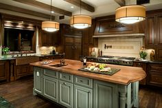 This kitchen is perfection. Copper apron front sink, light blue island, gorgeous backsplash and beautiful wood! Designed by; Richard W. Herb