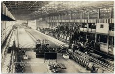 This is a vintage real photo postcard of Rolling Mill Rouge Steel plant, part of Ford Motor Company. It's published by The Carraway Company of Rutherford, New Jersey.