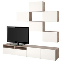 IKEA - BESTÅ, TV storage combination, walnut effect light gray/Selsviken high-gloss/white, drawer runner, soft-closing, , The drawers and doors close silently and softly, thanks to the integrated soft-closing function.The space-saving wall cabinets make the most of the wall area above your TV.It's easy to keep the cords from your TV and other devices out of sight but close at hand, as there are several cord outlets at the back of the TV bench.The cable outlet at the top lets cords run down…