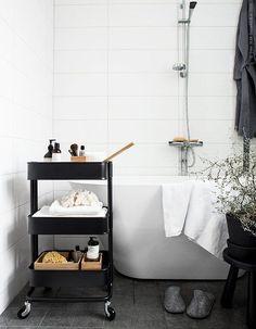 Bar cart in bathroom to hold bath products storage