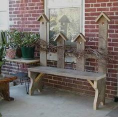 Birdhouses on picket making primitive Garden bench. This looks easy to do.always looks easy but getting there is a different story! I would add the old iron head board and put bird house on the seat!