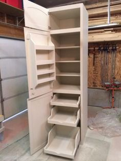 Pantry for a tiny kitchen in a tiny house. I love the pull out shelving and cabinets. Great space saving and multi-functional solution for small spaces. Kitchen Redo, Kitchen Storage, Kitchen Design, Kitchen Small, Cheap Kitchen, Kitchen Hacks, Kitchen Corner, Pantry Design, Diy Storage